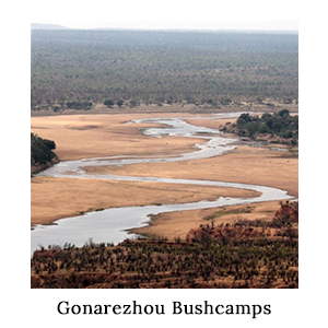 A view of a river winding through a sandy valley in Zimbabwe on a walking safari with Gonarezhou Bushcamps