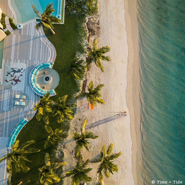 Aerial view of the sea, beach, palms, pool, and deck at Time + Tide Miavana, Nosy Ankao, Madagascar