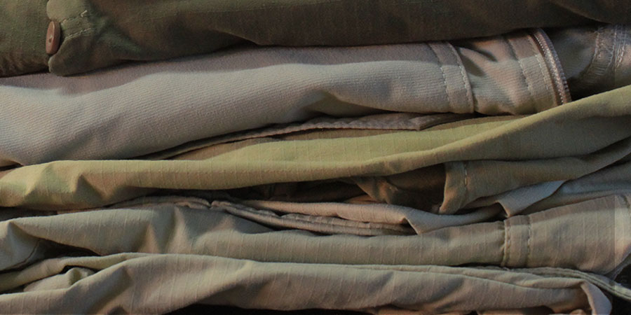 A pile of fashionable safari clothes as a guide on what to wear on safari