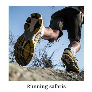 A man trail running in running shoes and clothing on an active safari in Africa