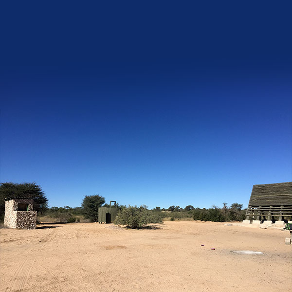 A rustic campsite with a longdrop, shower and A-frame in Mabuasehube in the Kgalagadi Transfrontier Park in Botswana