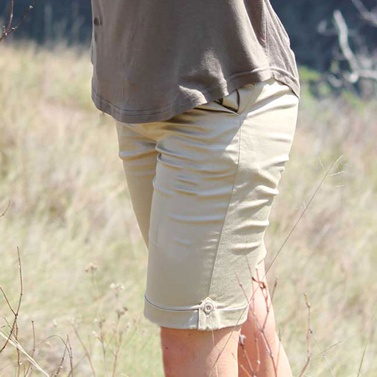Woman wearing summer bermuda shorts with stretch