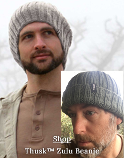 Man wearing hand knitted beanie.