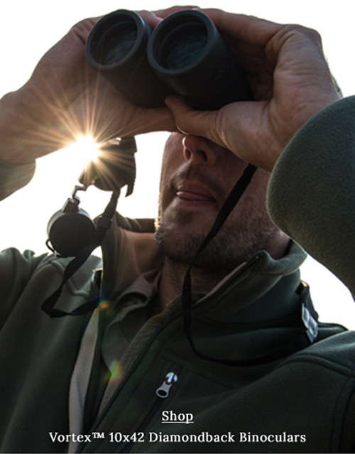 Man using Vortex Diamondback 10 x 42 binoculars.
