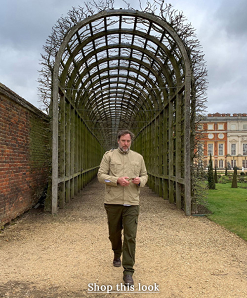 Man in summer safari clothing at hampton court palace.