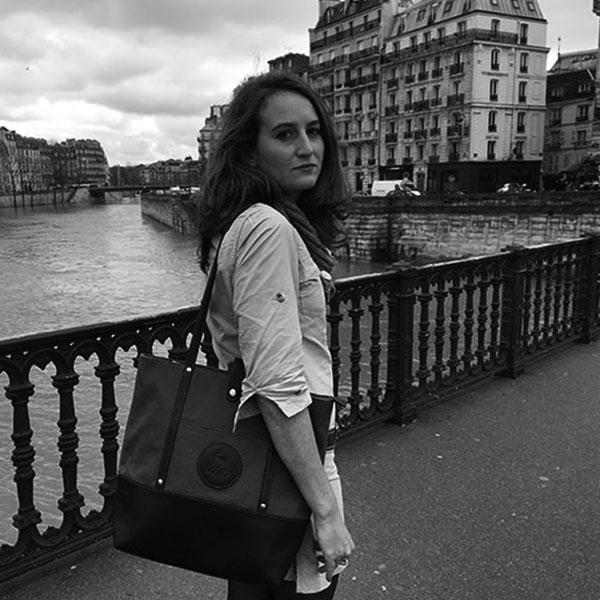 Woman in Paris wearing safari style clothing.