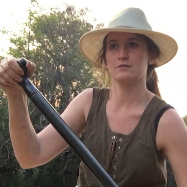 Claire paddling on expedition on the Kafue River