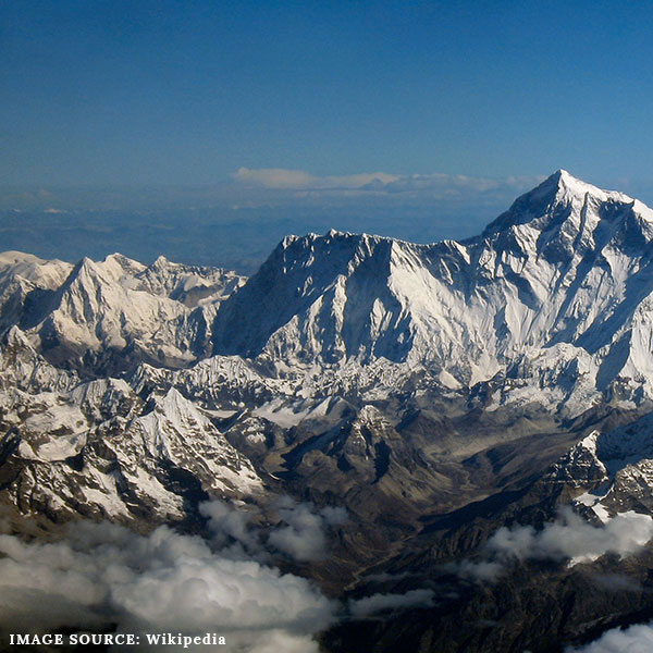Aerial view of the grey Himalayan mountains with snow and clouds. Steve Backshall's recommended destination