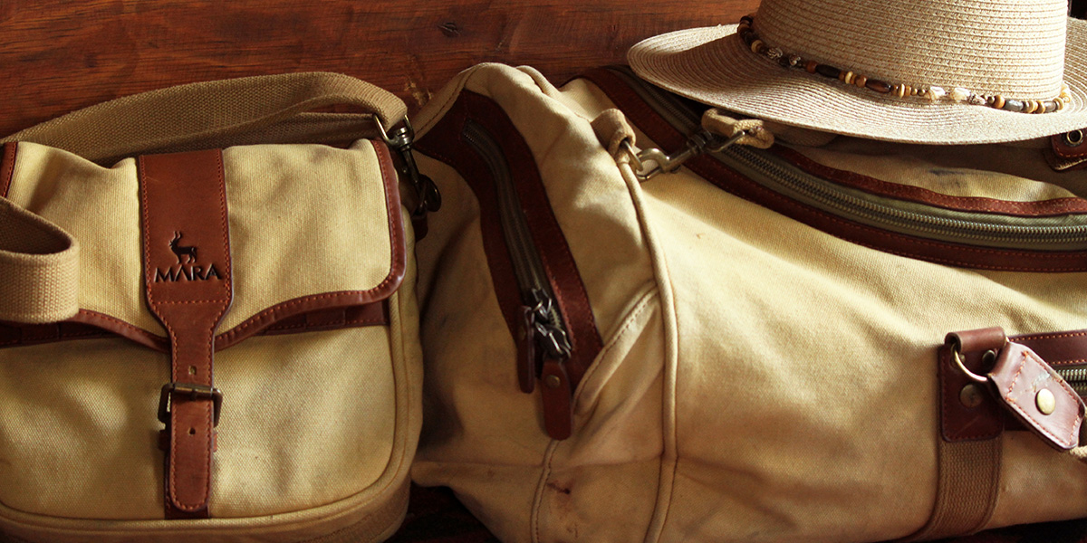 Canvas and leather luggage as a guide on what to pack for safari